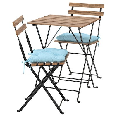 TÄRNÖ table+2 chairs, outdoor black/light brown stained/Kuddarna light blue