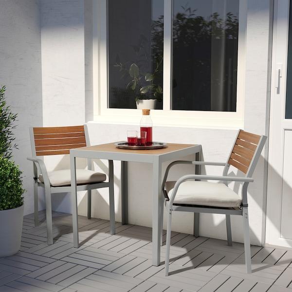 SJÄLLAND Table+2 chairs w armrests, outdoor, light brown/Frösön/Duvholmen beige, 71x71x73 cm