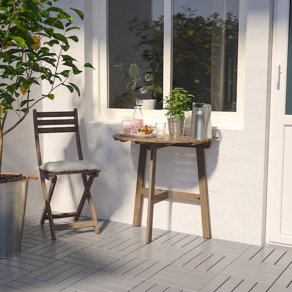 ASKHOLMEN طاولة حائطية+كرسي قابل للطي، خارجية, صباغ رمادي-بني/Kuddarna بيج