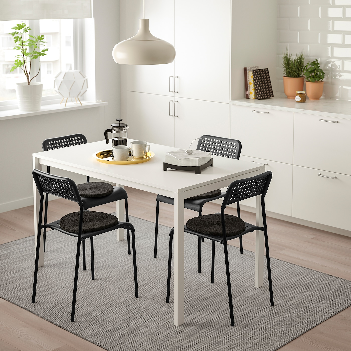 Picture of: Melltorp Adde Table And 4 Chairs White Black Ikea