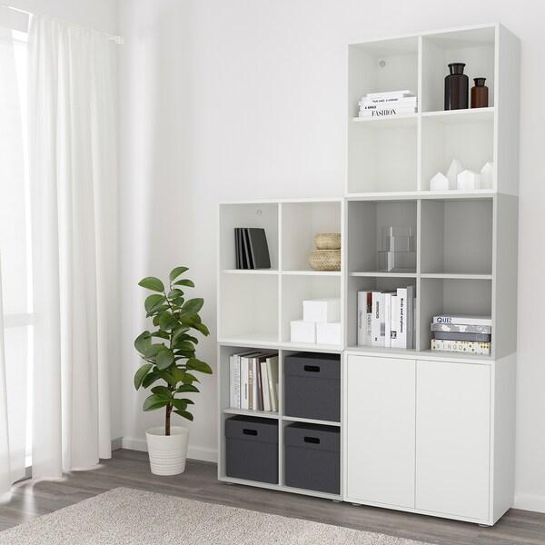 EKET Skåpkombination med fötter, vit/ljusgrå, 140x35x212 cm