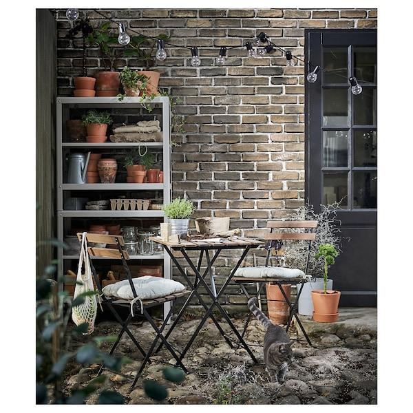 TÄRNÖ Stol, utomhus, akacia hopfällbar svart, gråbrunlaserad