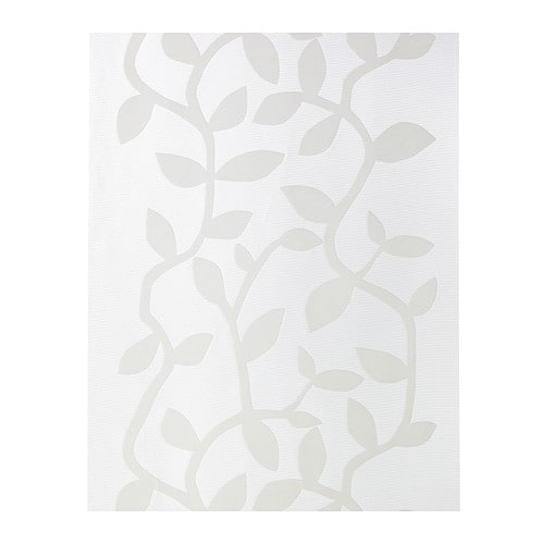 ÅDERBLAD Panel curtain IKEA The pattern is slightly raised from the sheer background, creating a decorative play of light and shadow.