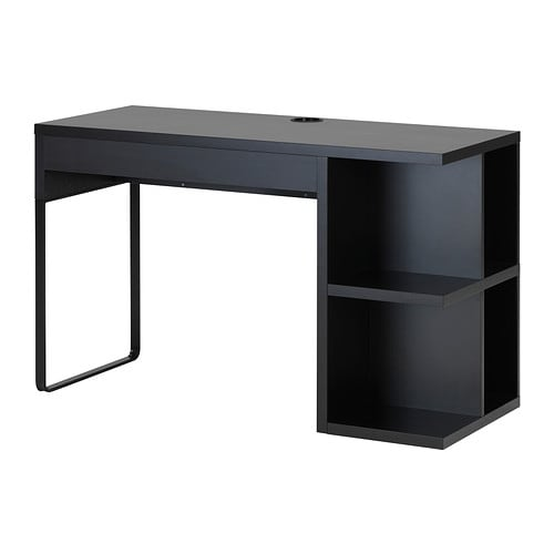 MICKE Desk with integrated storage IKEA It's easy to keep sockets and cables out of sight but close at hand with the cable outlet at the back.