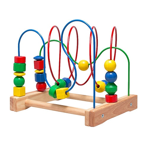 MULA Bead roller coaster IKEA Moving wooden beads on a track is a fun way to learn about colours and shapes.