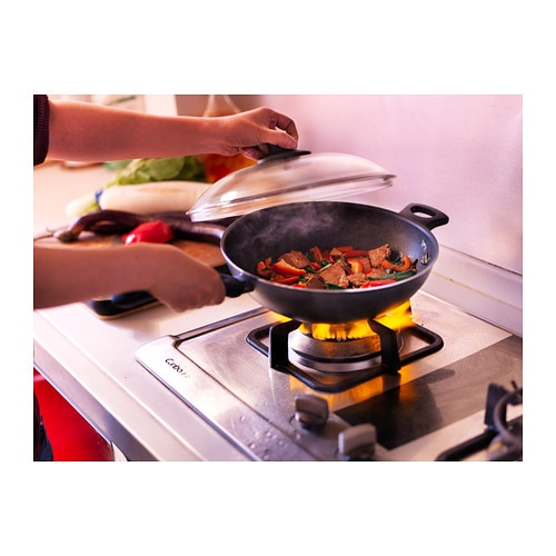 SKÄNKA Wok with lid IKEA Comfortable handles make the cookware easy to lift.