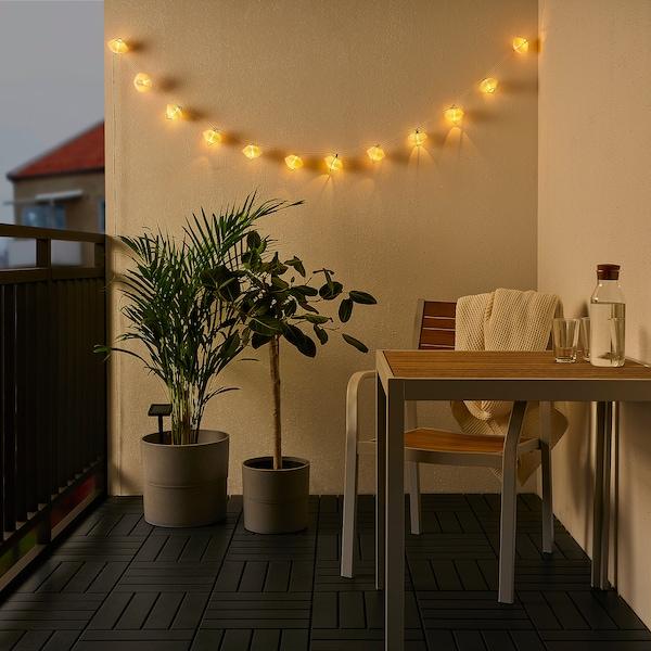 SOLVINDEN LED svetlobna veriga z 12 lučkami, oranžna modra/zunanje solarno napajanje