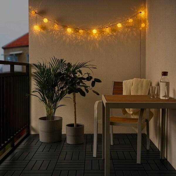 SOLVINDEN LED svetlobna veriga z 12 žarnicami, na baterije/bela bež