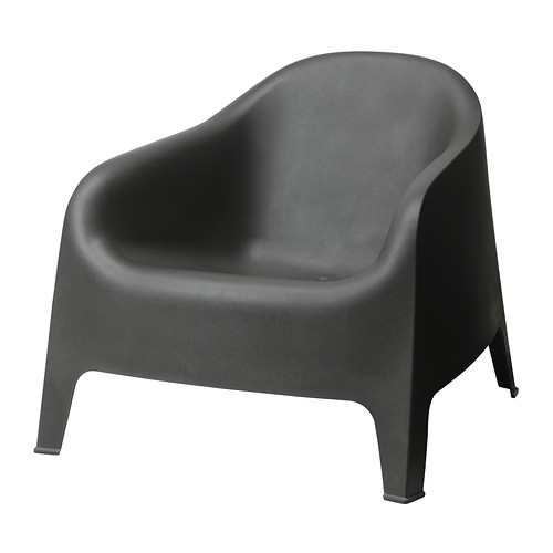 SKARPÖ Armchair   Cut out design in the seat; allows water to drain through.