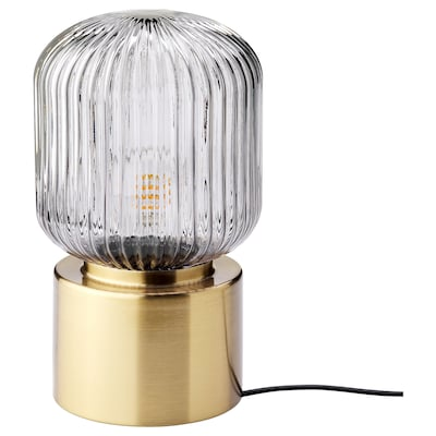 SOLKLINT Table lamp, brass/grey clear glass, 28 cm