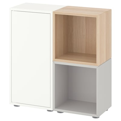 EKET เอียคเกท ตู้หนังสือพร้อมปุ่มรองตู้, ขาว/เทาอ่อน/สีไวท์โอ๊ค, 70x25x72 ซม.