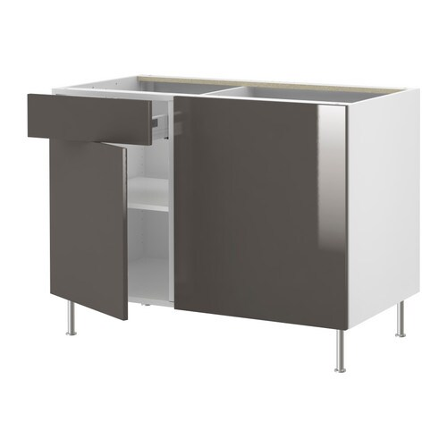 AKURUM Corner base cabinet with shelf IKEA Adjustable shelf; adapt spacing to your own storage needs.