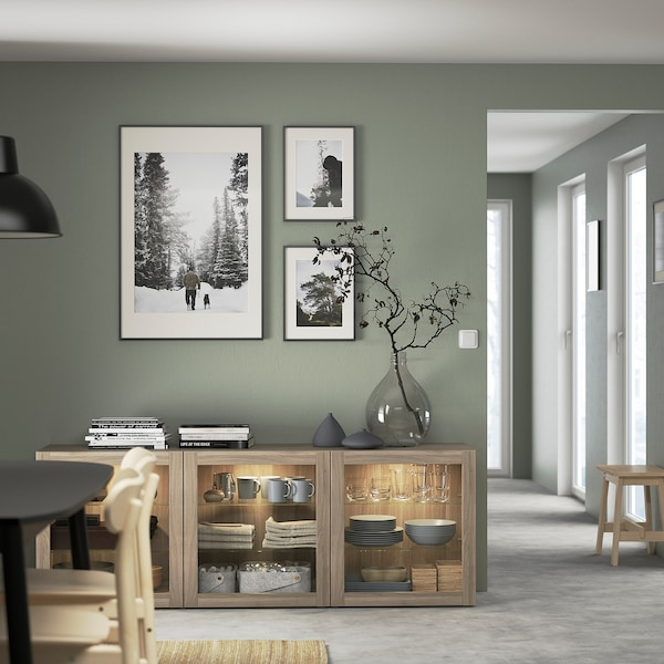 "BESTÅ Storage combination with doors, walnut effect light gray/Sindvik gray stained walnut eff clear glass, 70 7/8x16 1/2x25 5/8 """
