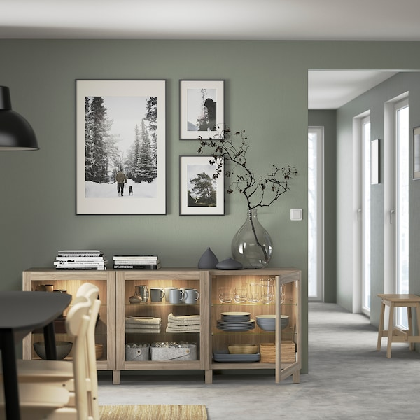 "BESTÅ Storage combination with doors, walnut effect light gray/Sindvik/Stubbarp gray stained walnut eff clear glass, 70 7/8x16 1/2x29 1/8 """