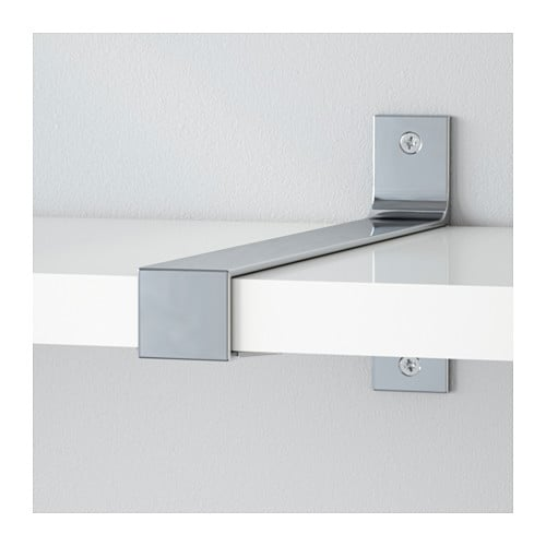 EKBY BJÄRNUM Connecting bracket IKEA Connects 2 shelves for a larger shelf combination.  Partitioning wall inside keeps shelves in place.