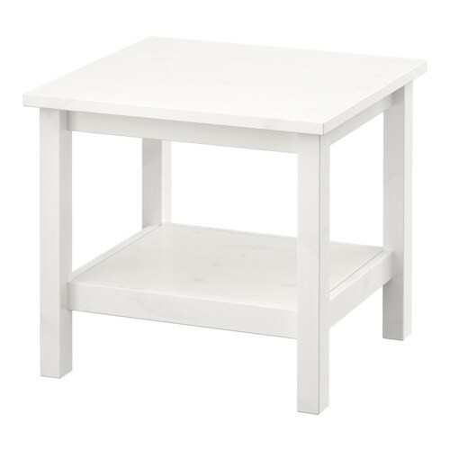 HEMNES Side table IKEA Solid wood; gives a natural feel.  Separate shelf for storing magazines, etc.