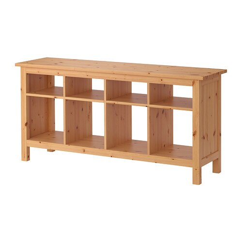 HEMNES Sofa table IKEA Solid wood has a natural feel.  8 compartments in two different sizes.