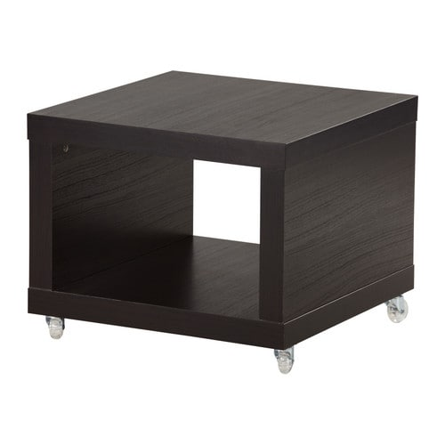 LACK Side table on casters IKEA Includes casters, making it easy to move.  One open compartment for storing magazines, remotes etc.