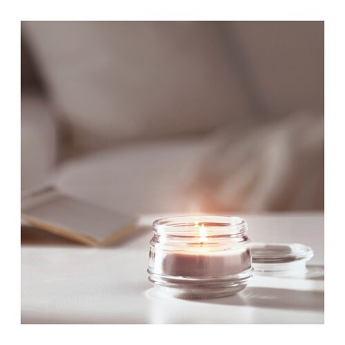 LUGGA Scented candle in glass IKEA Creates atmosphere with a pleasant scent of soft vanilla and warm candlelight.