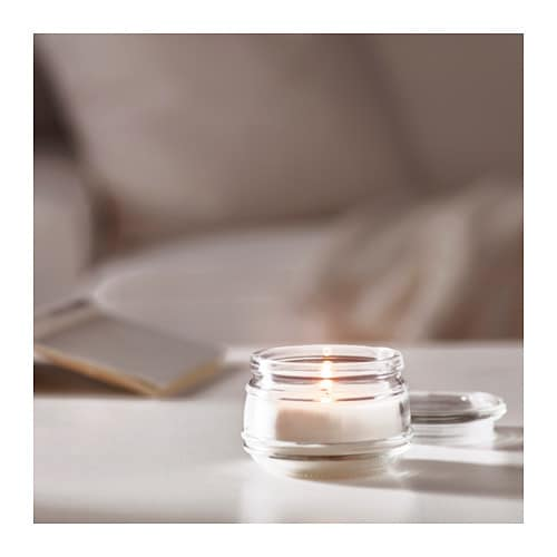 LUGGA Scented candle in glass IKEA Creates atmosphere with a pleasant scent of fresh linen and warm candlelight.