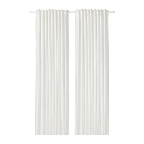 MILDRID Curtains, 1 pair IKEA The curtains let the light through but provide privacy so they are perfect to use in a layered window solution.