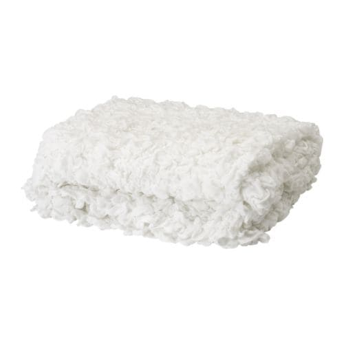 "OFELIA Blanket IKEA Stretchable; fits beds up to 70 7/8"" wide."