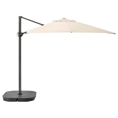 "SEGLARÖ / SVARTÖ Hanging umbrella with base, tilting beige/dark gray, 129 7/8x94 1/2 """