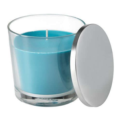 SINNLIG Scented candle in glass IKEA Creates atmosphere with a pleasant scent of beach breeze and warm candlelight.