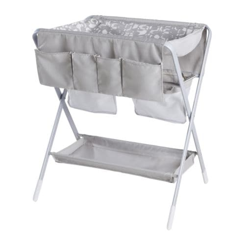SPOLING Changing table IKEA Foldable; easy to store when not in use.  The cover and the storage pockets are washable and easy to put on and take off.